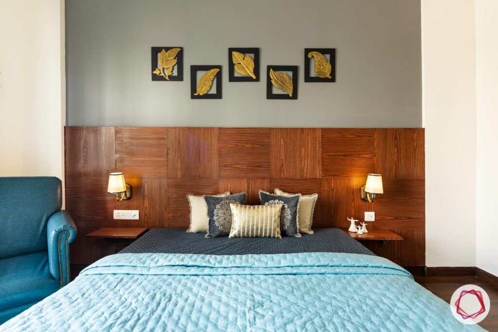 bedroom accent wall-wood wall-grey wall designs-wall art-blue accent chair