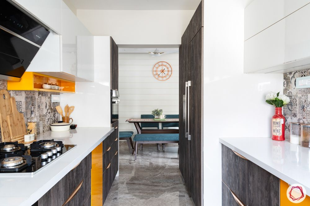 home renovation mumbai-white and brown cabinets-orange cabinets-parallel layout
