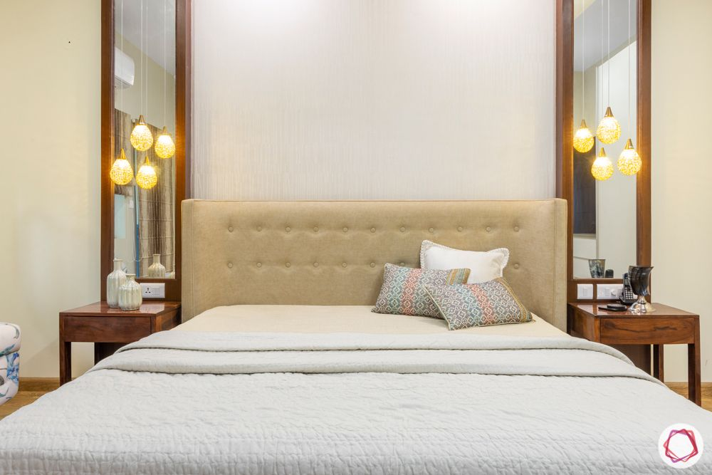 ardee city-master bedroom-wooden flooring-soft headboard-mirror and side table