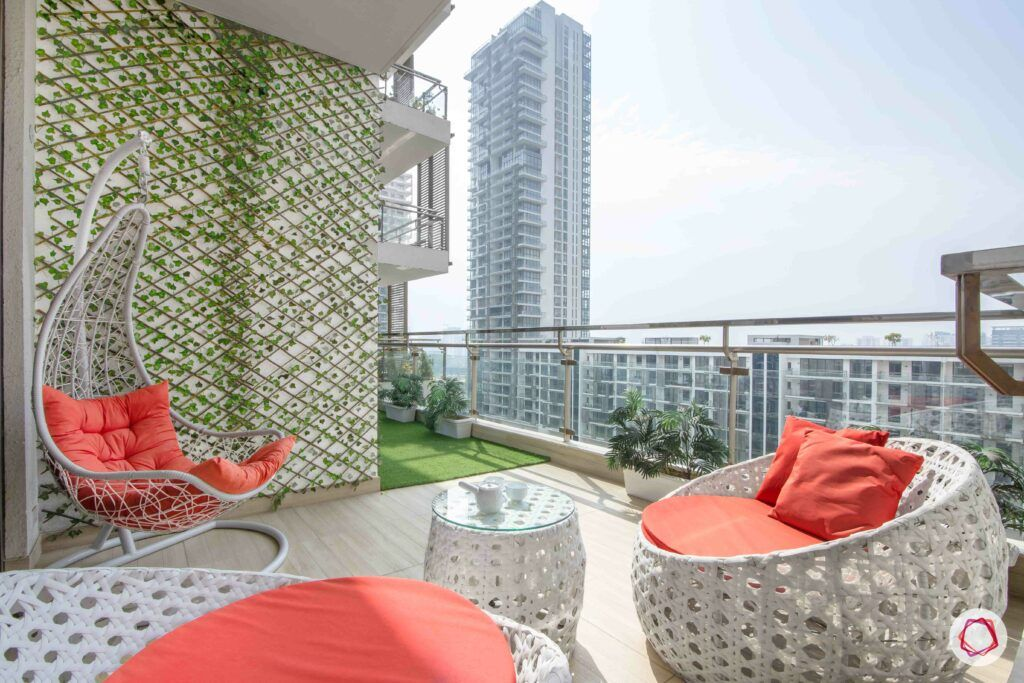 large balcony design ideas-coral cushions-white wicker furniture