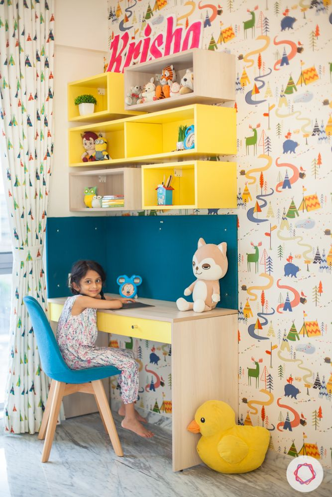 home in pune-yellow study table-printed wallpaper-display shelves