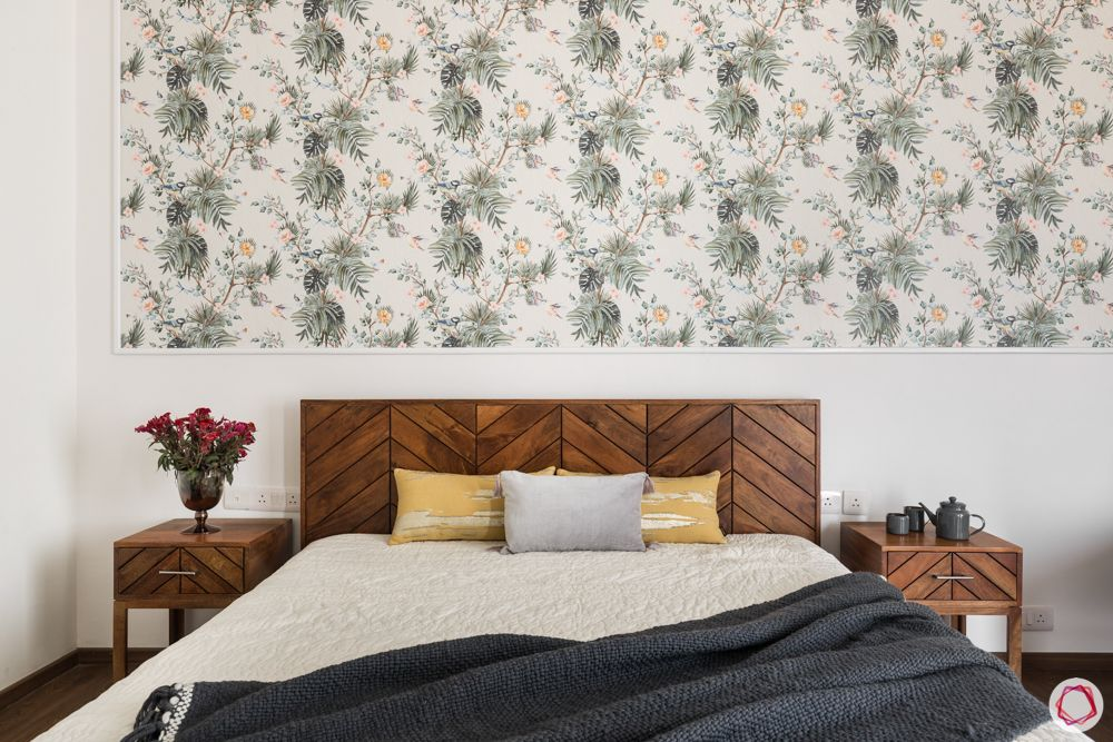 4 bhk apartment-wooden bed-floral wallpaper-white walls-wooden bedside table