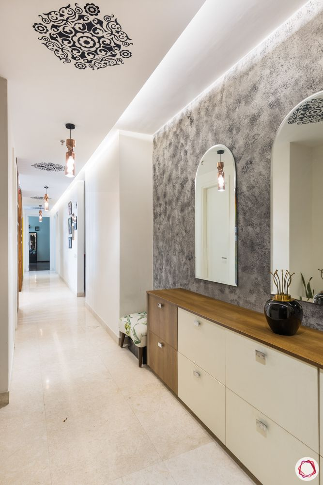 4 bhk apartment-living room-mirror foyer-ceiling motif-grey wall