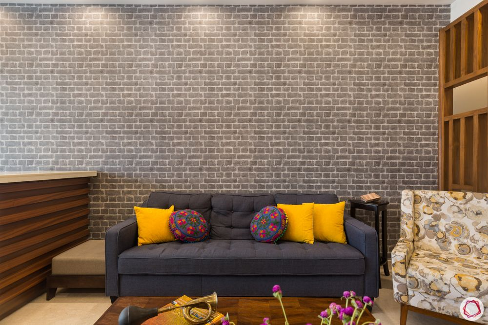 4 bhk apartment-living room-wooden partition-pattern cushions-grey sofa