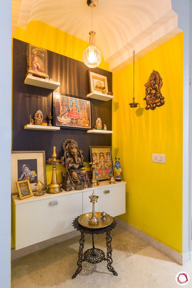4 bhk apartment-yellow walls-floating shelves-pendant light