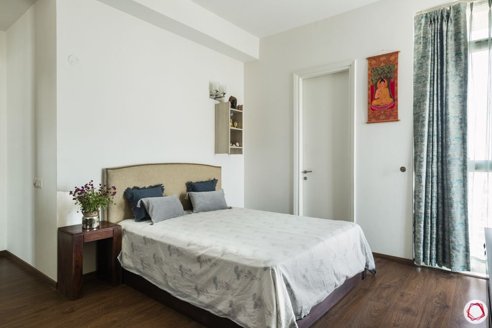 4 bhk apartment-beige bed-white walls-wooden side table