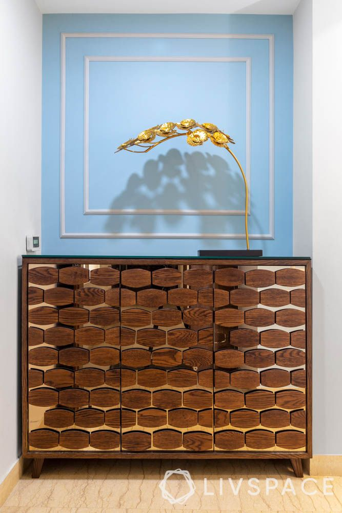 make your home look expensive-blue wall apint-metallic accents