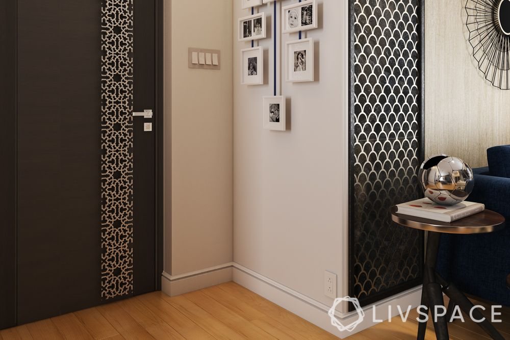 Foyer design-gallery wall-black and white-metallic accents