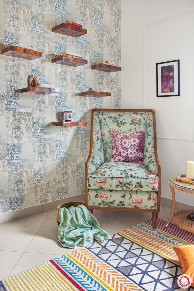 sobha-aspire-master-bedroom-reading-corner-floral-accent-chair-wall-shelves
