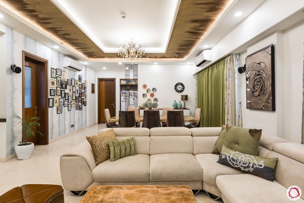 DLF-capital-greens-living-room-fiery-textured-paint-sofas
