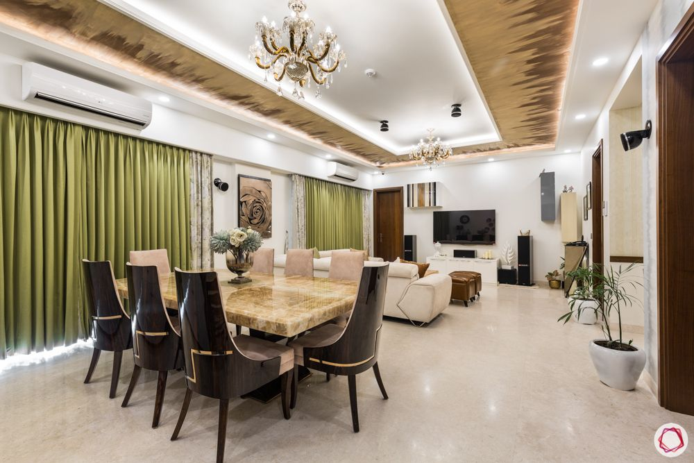 DLF-capital-greens-fiery-textured-paint-olive-curtains-chairs-table-dining