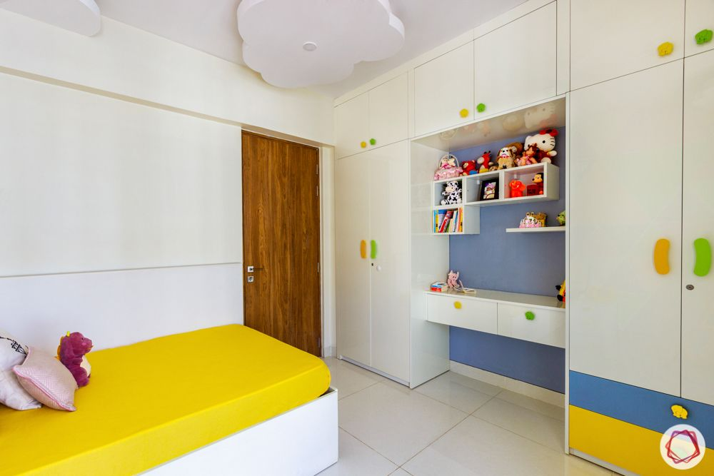 kids bedroom-white wardrobe-yellow bed-colourful handles