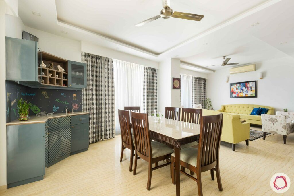 livspace gurgaon-wooden dining table designs-grey cabinet designs