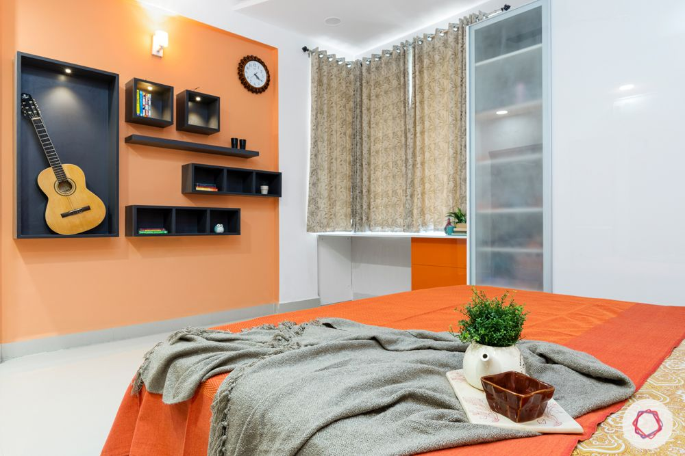 top interior designers in hyderabad-kids bedroom-white bed-orange acrylic wardrobes-orange wall paint