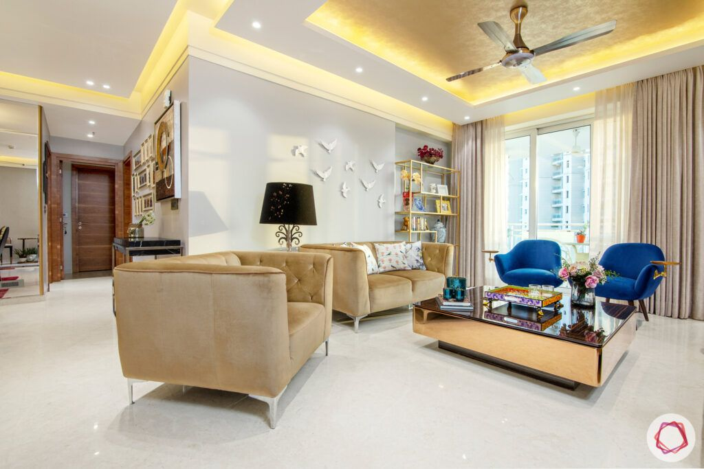 low budget home design- brown sofa set-blue chairs