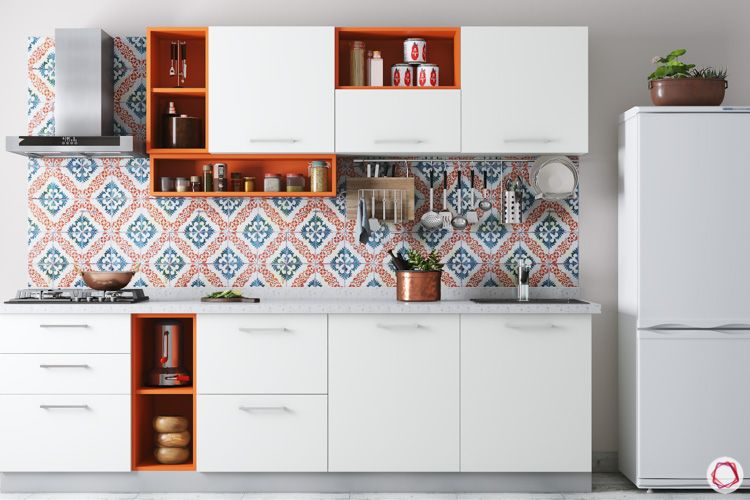 small compact kitchen ideas-orange and blue backsplash-fridge-chimney-white cabinets