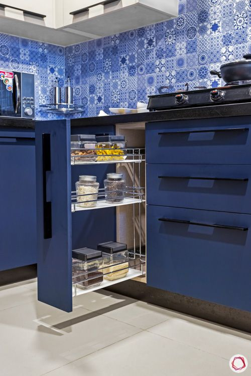 ark blue cabinets-pull out cabinet-blue tiled backsplash