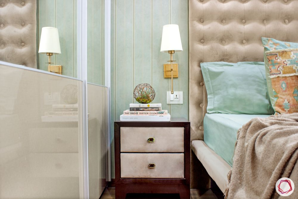 small room ideas-mounted lamp-pink headboard-pink side table-sliding wardrobe designs