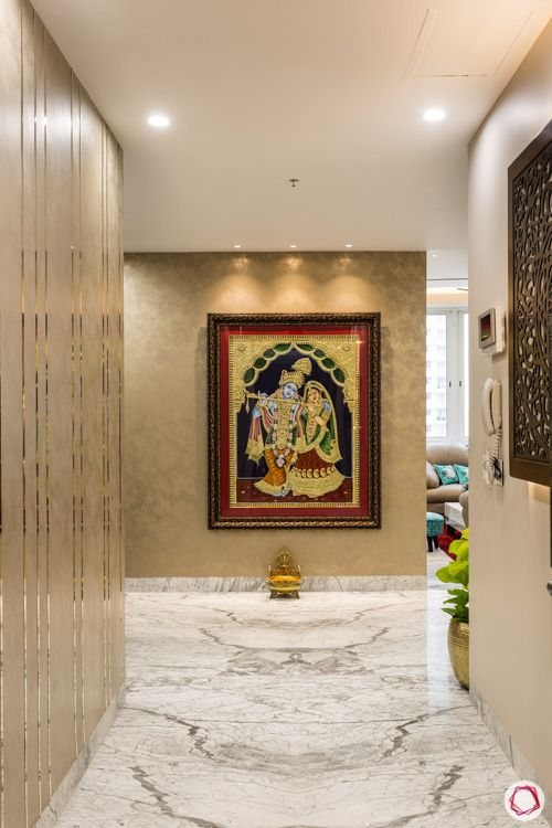 4 bhk flat-foyer-tanjore painting-chrome strips