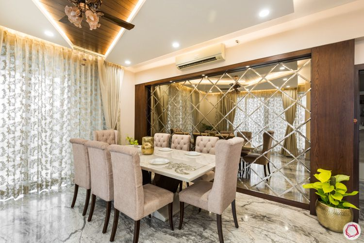 4 bhk flat-8 seater table-mirror panel-ceiling design