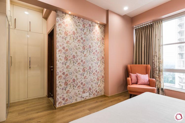4 bhk flat-floral wallpaper-glossy wardrobes-pink armchair-pink wall