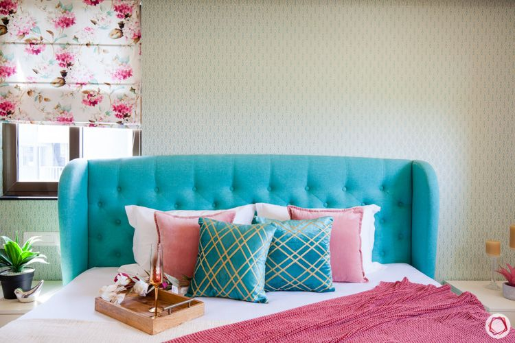 blue cushioned headboard-pink and blue pillows-floral blinds