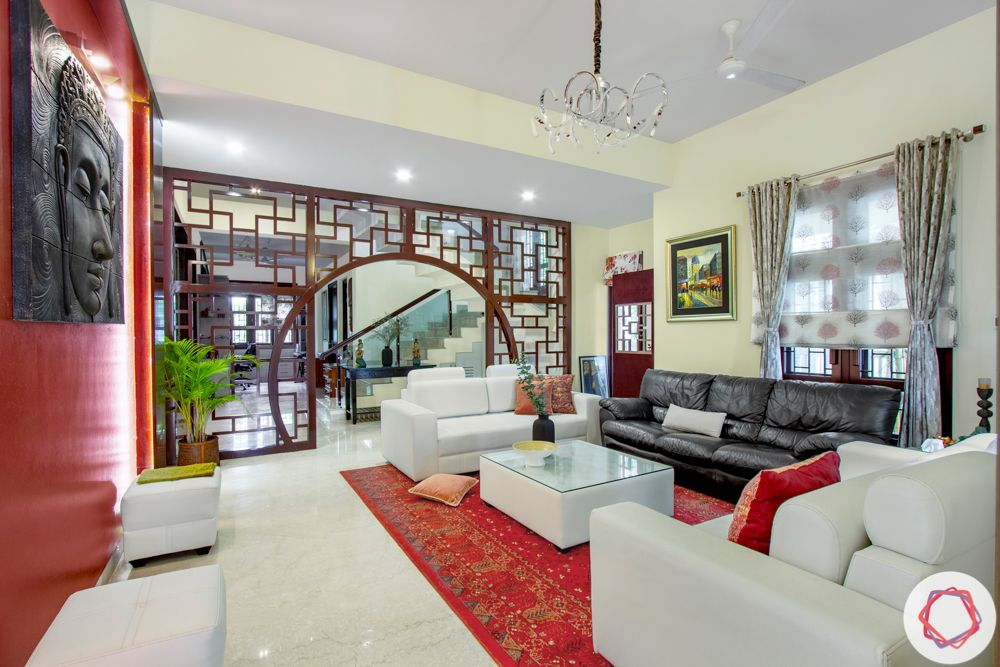 nambiar bellezea-living room-mdf partition-white sofa designs-accent wall-buddha wall mount