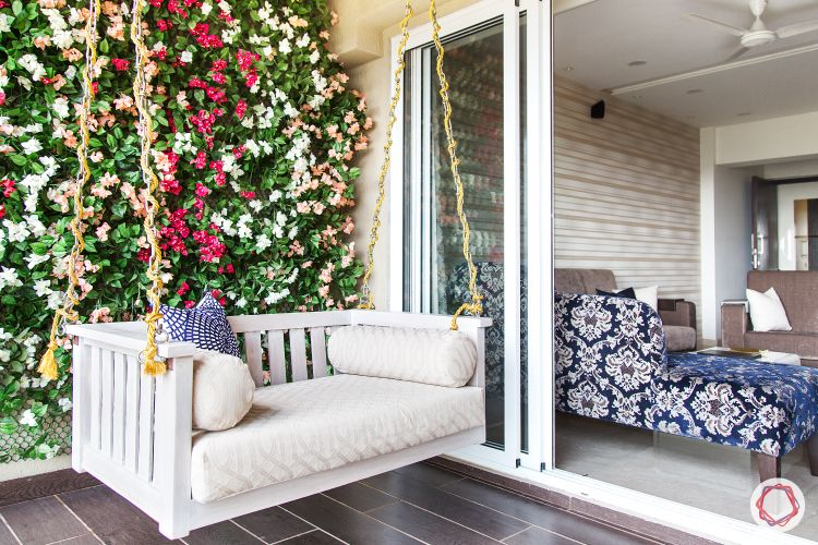 outdoor balcony design-white daybed swing-swing designs-vertical garden