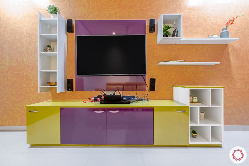 madhavaram serenity-living room-yellow sofa set-wooden partition-green and purple cabinets-Tv unit