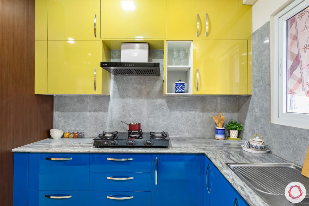 madhavaram serenity-kitchen-blue and yellow designs-tall unit-high gloss cabinets