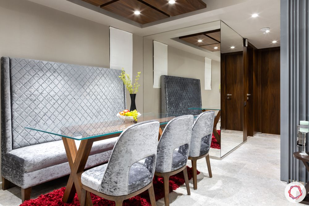 lodha-elisium-dining-room-high-back-bench-glass-wall-panels