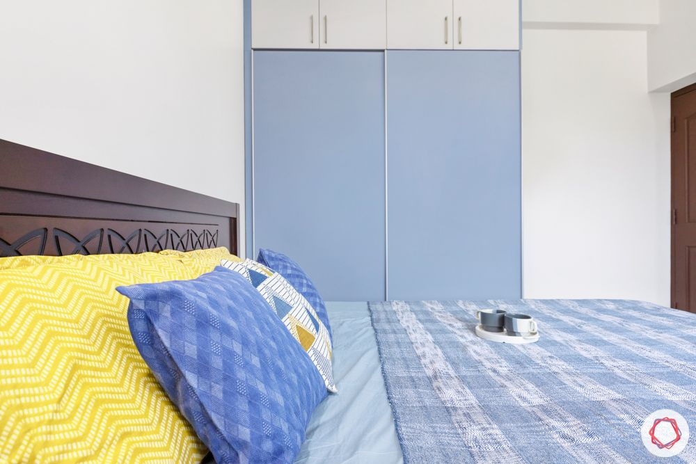 interior design for 3bhk flat-light blue wardrobe-denim finish wardrobe
