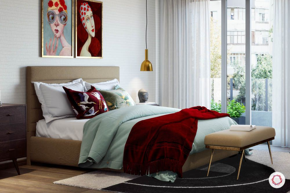 jewel toned interiors-red bedding-red armchair-standing lamp-wall art