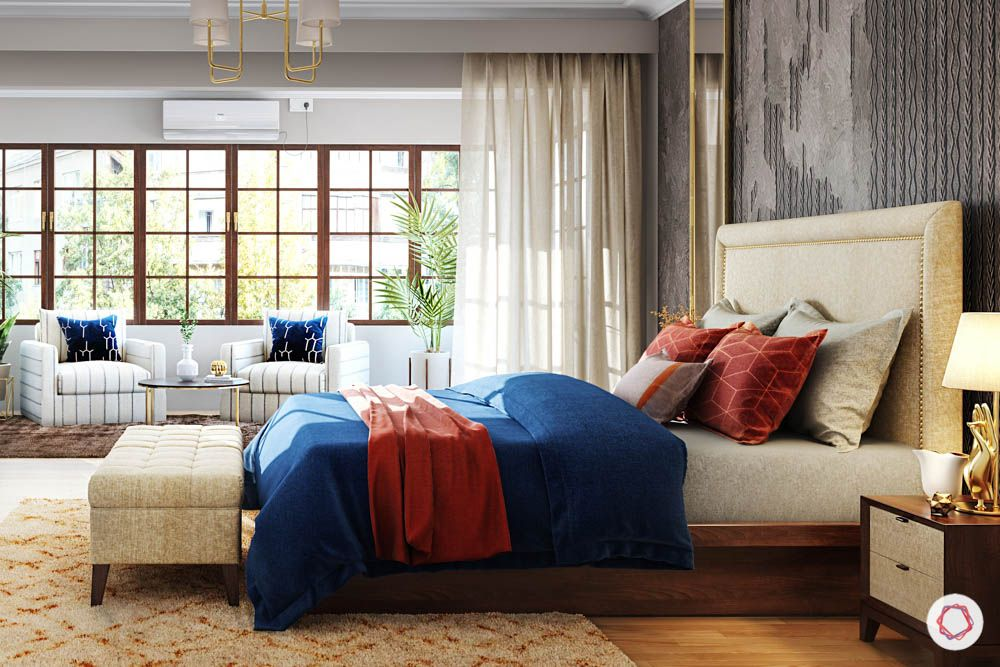 jewel toned interiors-blue bedding-headboard-white armchairs