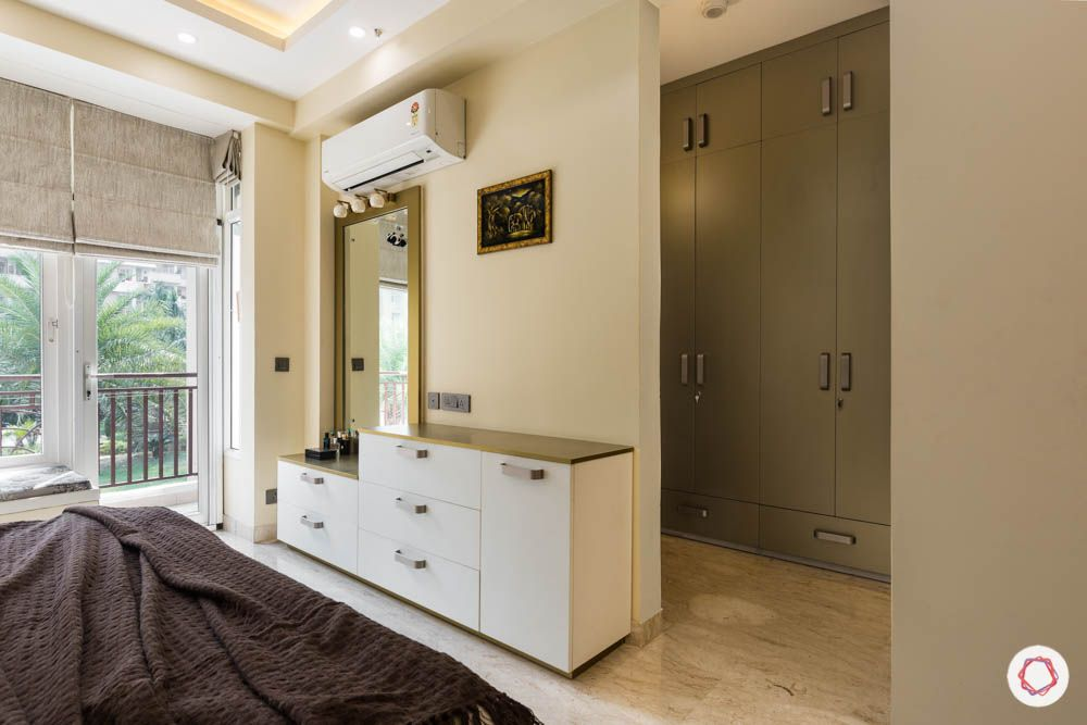 walk in closet-wardrobe designs-room partition-swing door-white vanity unit