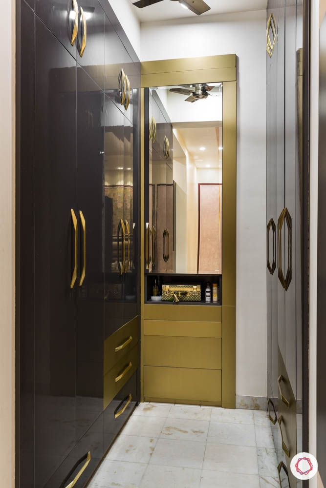 walk in closet-wardrobe designs-gold mirror vanity-black swing doors