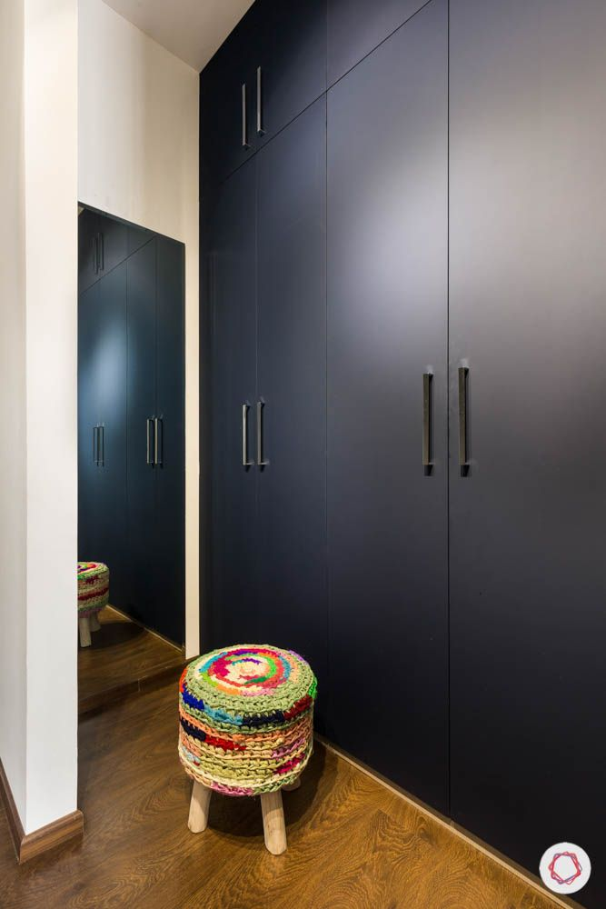 wardrobe designs-grey swing doors-colourful ottoman