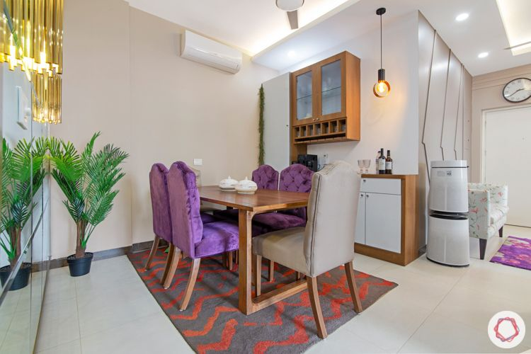 Living room colours-purple velvet upholstered chairs-crockery unit