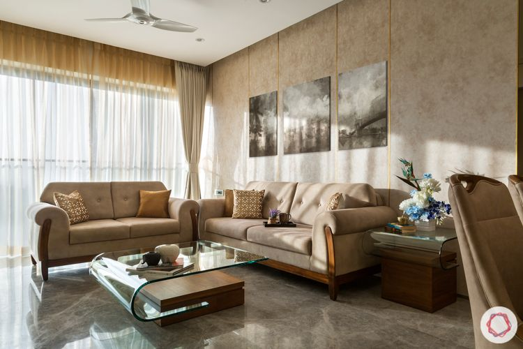 Beige wallpaper-beige sofas-glass center table