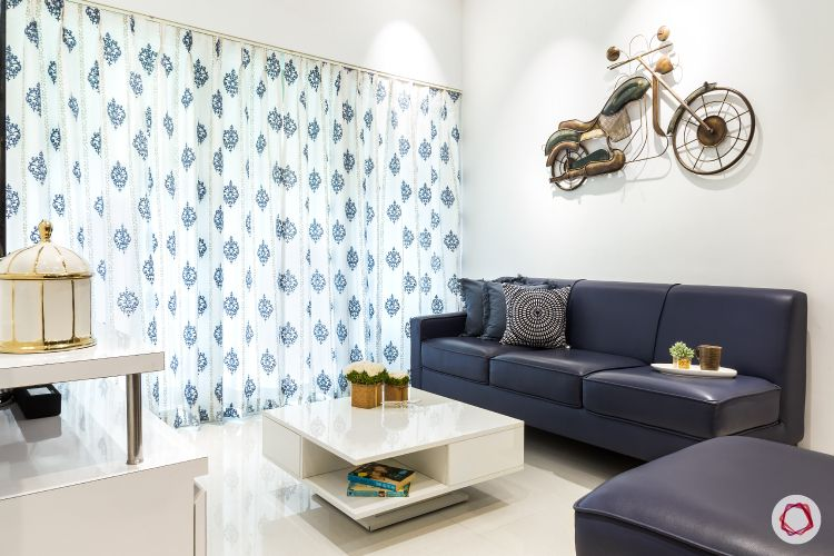 metal fixtures-wall mount-blue curtains-blue sofa