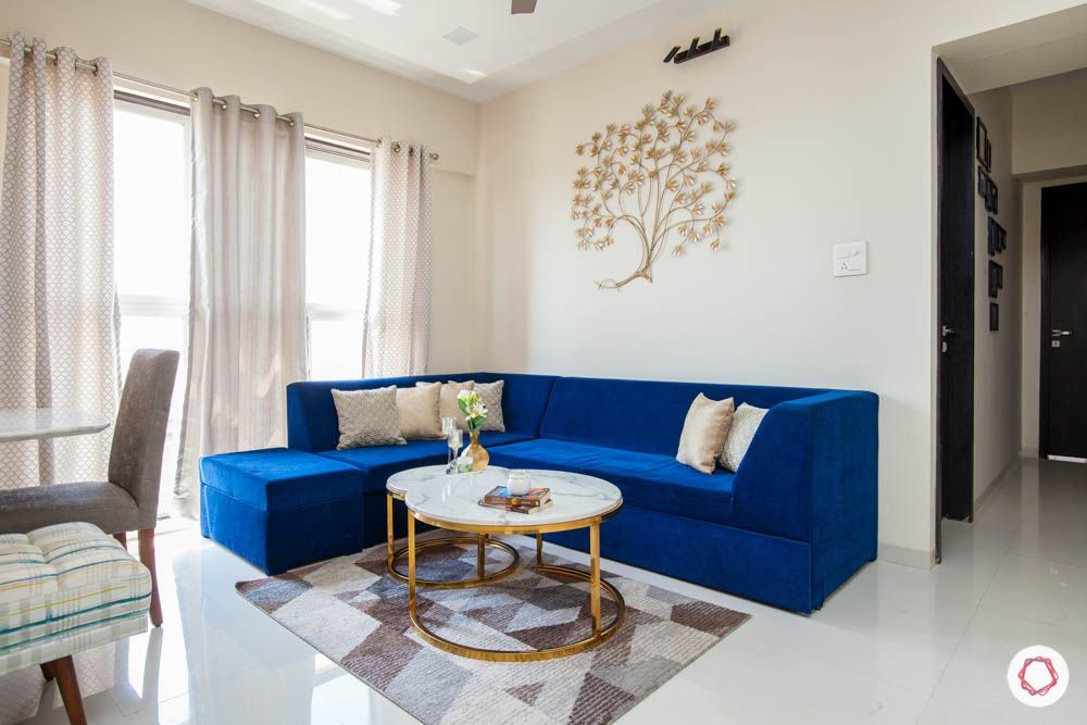 blue-sofas-sophisticated-metallic-accents