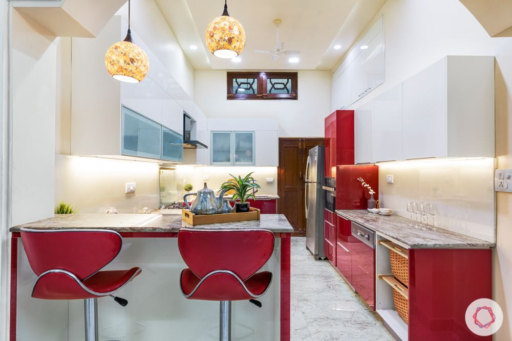 best interior designers in hyderabad-red chairs-red kitchen-pendant lighting