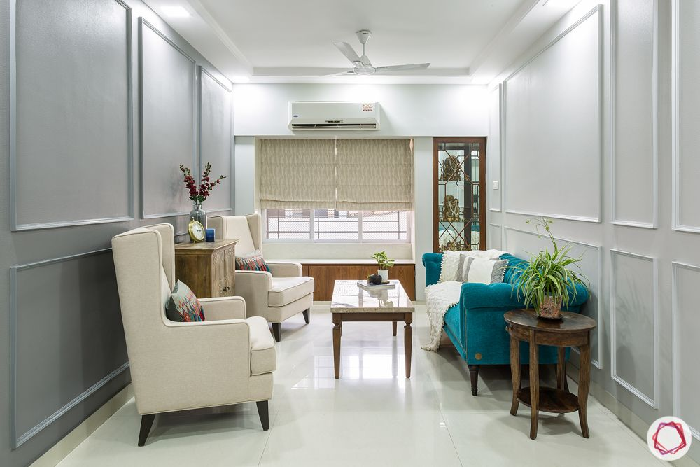 interior design in mumbai-blue sofa designs-white winged back chair