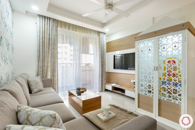 2 bhk flat interior design-living room-tv unit-pooja unit-walnut finish -grey sofa