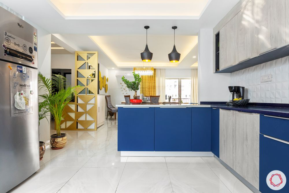 4 bhk home design-pendant lights-whire and blue cabinets