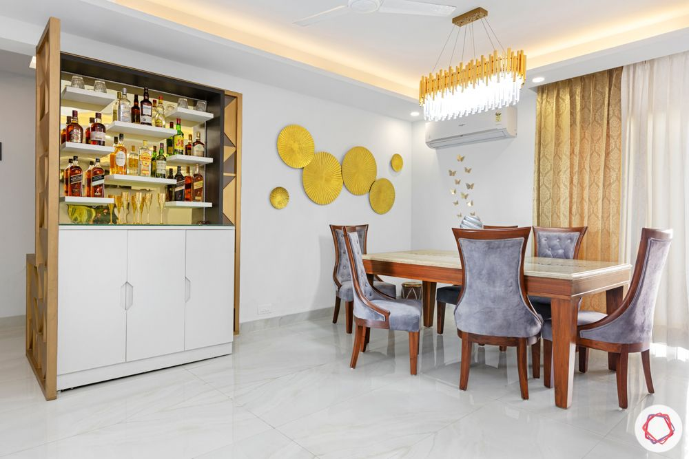 4 bhk home design-chandelier-velvet dining table-bar unit
