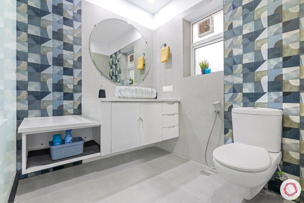 4 bhk home design-blue and grey tiles-bathroom cabinets