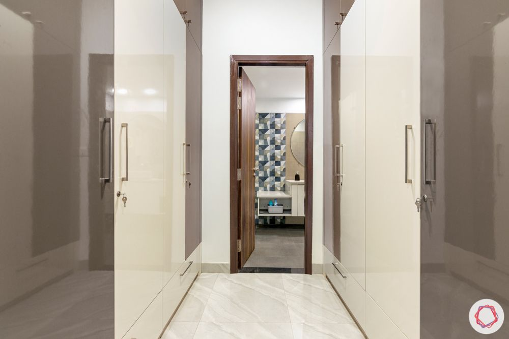 4 bhk home design-brown and white wardrobes-walk-in closet