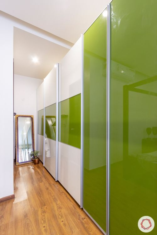 interior companies in bangalore-four-poster bed-wooden flooring-green wardrobes
