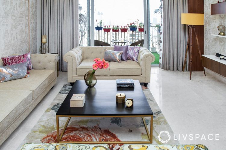 center table buying tips-beige sofa-square coffee table-standing lamp